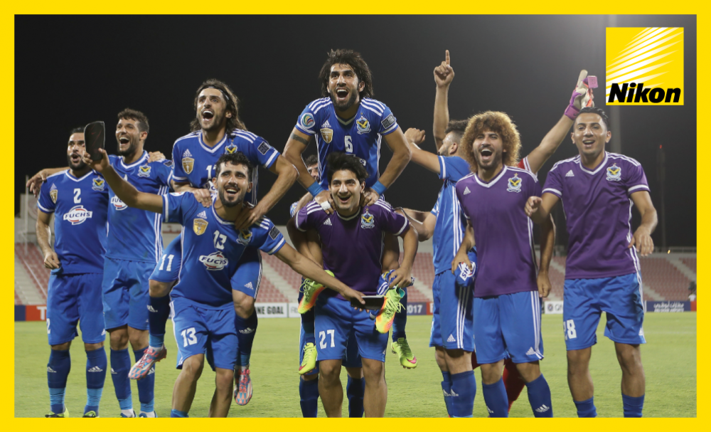 Air Force Club's AFC Cup title defence continues after the Iraqi side defeat compatriots Al Zawraa 2-1 on aggregate to progress to September's West Asia Zonal final.