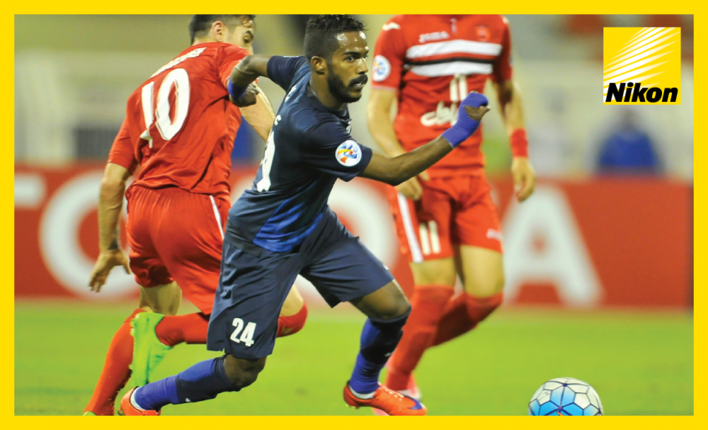 Al Hilal's Nawaf Al Abid evades opponents as the Saudi side play out a scoreless draw with Persepolis on Matchday Five to advance to the AFC Champions League knockout round with a game to spare on Monday.