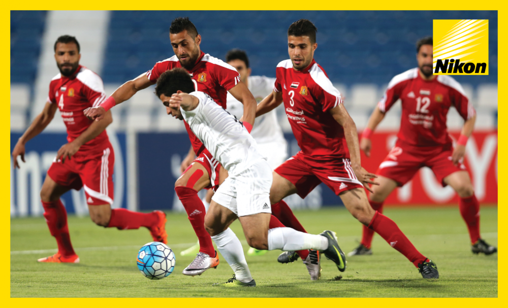 Al Jaish defence look to regain possession during 3-0 defeat to Iraq's Al Zawraa on Matchday Four as Syrian side concede top spot in Group A of the 2017 AFC Cup.