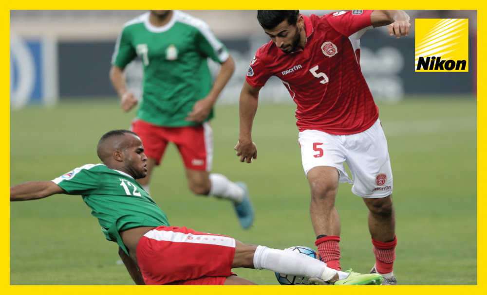 Fadi Awad goes in hard on Hesham Nayem as Jordan's Al Wehdat overcome Bahrain's Al Muharraq 3-2 on Monday to book their place in the AFC Cup Zonal Semi-finals as Group C winners.