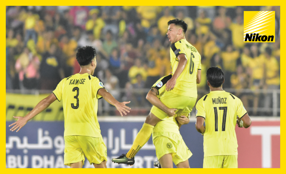 Ceres Negros players salute goalscorer Kevin Ingreso as the side from the Philippines move to the top of Group G of the AFC Cup with a stunning 6-2 win over Vietnam's Hanoi FC on Wednesday.