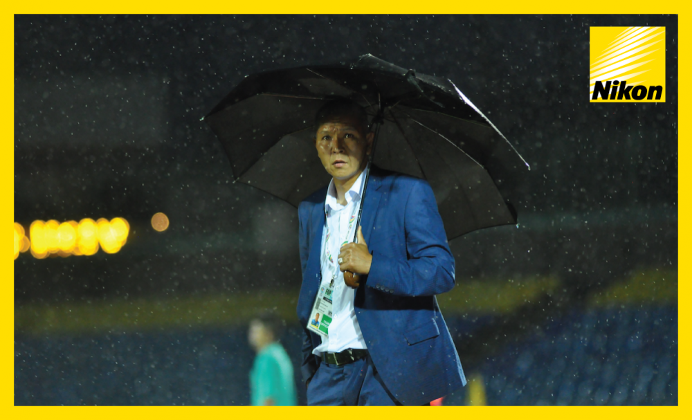 Dordoi FC coach Murat Dzumakeev shields himself from the downpour but the goals rain in on the pitch as AFC Cup Group D leaders FC Istiklol of Tajikistan claim a 4-1 victory over the Kyrgyz Republic side on Wednesday.