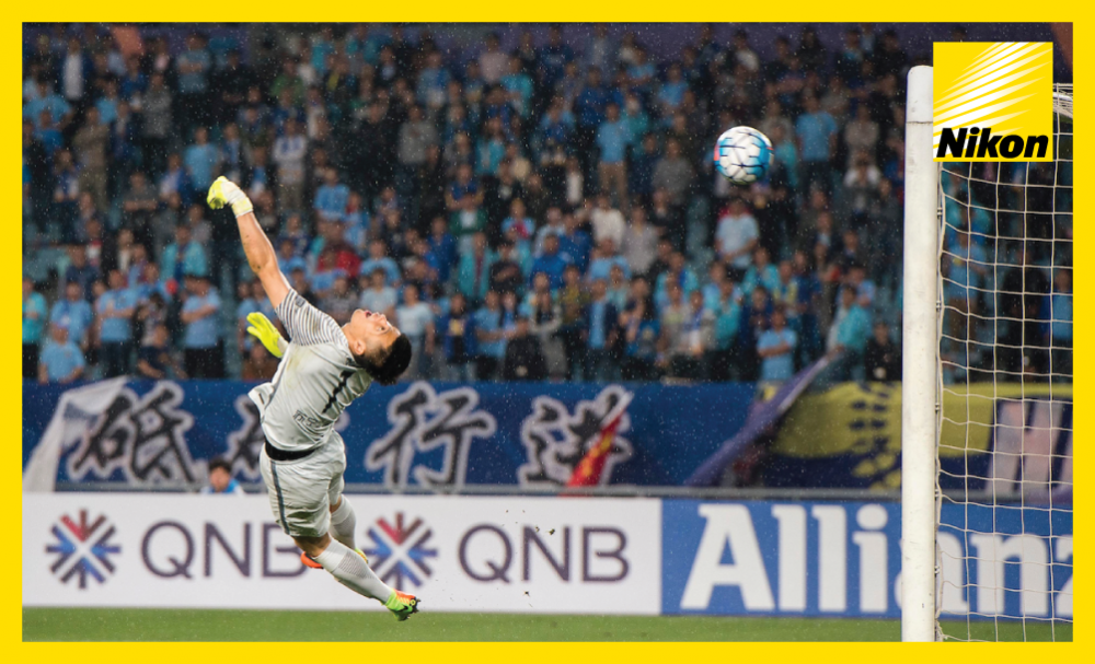 Jiangsu FC goalkeeper Gu Chao can do nothing to stop Lee Chang-min's excellent winner as Jeju United run out 2-1 victors on Tuesday to move second in Group H of the AFC Champions League.