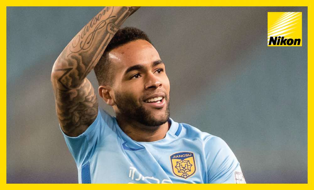 Alex Teixeira celebrates his opener in Jiangsu FC's 3-0 AFC Champions League victory over Gamba Osaka on Tuesday as the Chinese outfit become the first team to advance to the last 16 as Group H winners.