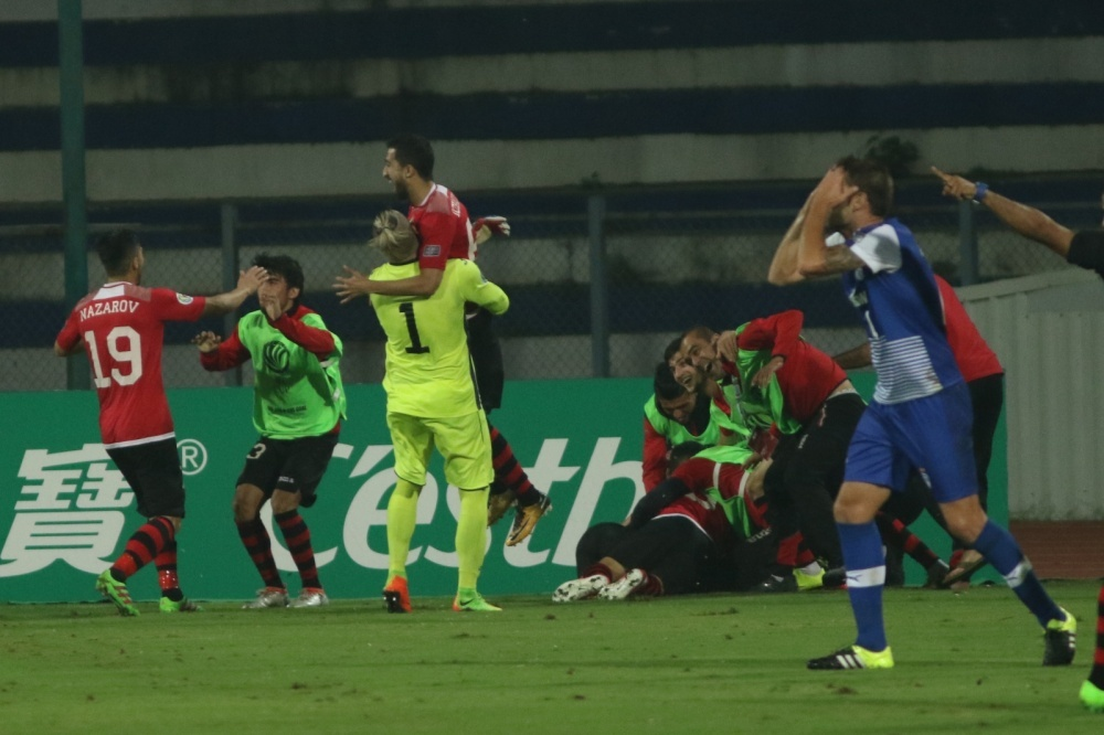 Juanan of India's JSW Bengaluru puts his head in his hands as Tajikistan's FC Istiklol celebrate going 2-1 up in their AFC Cup Inter-Zone final second leg on Wednesday, before advancing to November's final with holders Air Force Club of Iraq following a 3-2 aggregate victory.