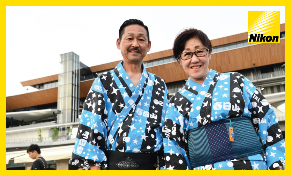 Home supporters in traditional clothing pose for the cameras outside Todoroki Stadium ahead of Kawasaki Frontale's 4-1 win – and 7-2 aggregate victory – over Muangthong United in the second leg on Tuesday.