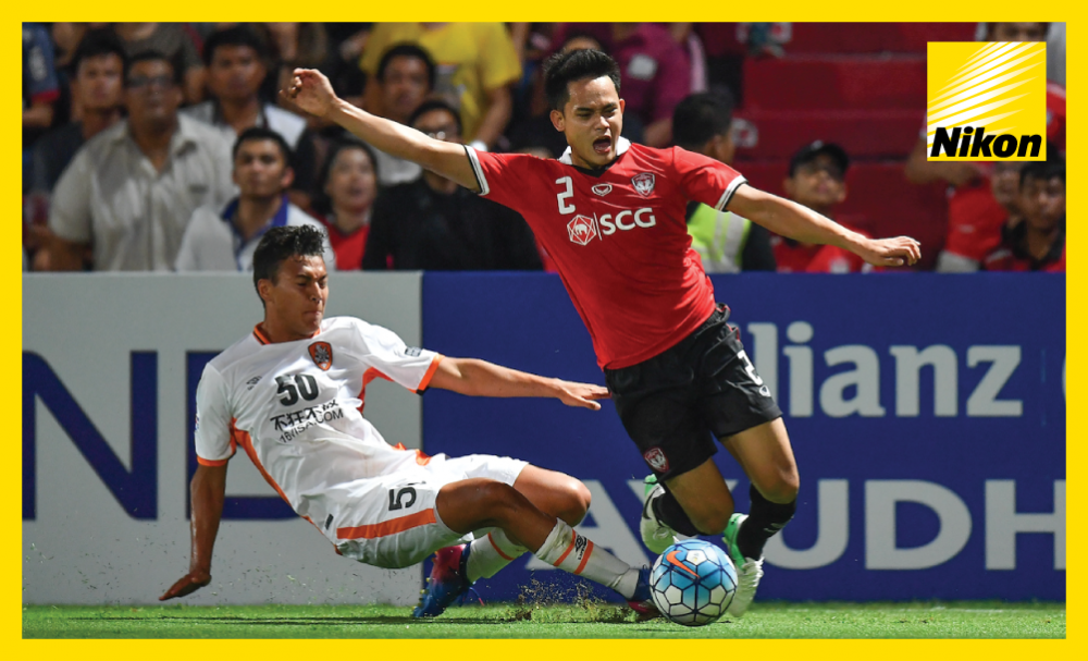 Peerapat Notchaiya is brought down by Dane Ingham on Wednesday but will care little as Muangthong United defeat Brisbane Roar 3-0 in Group E to advance to the AFC Champions League last 16 for the first time.
