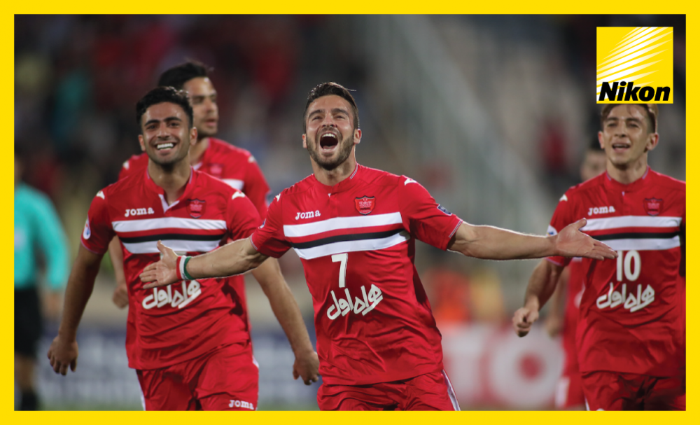 Soroush Rafieitelgary celebrates opening the scoring for Persepolis in a 4-2 victory over Al Wahda in Group D on Monday as the Iranian side advance to the AFC Champions League last 16.