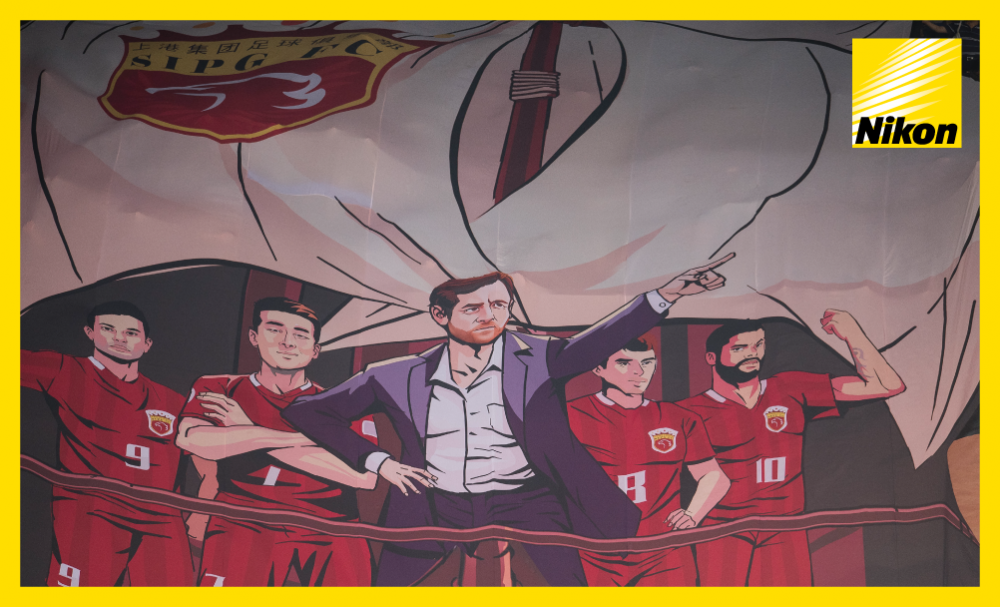 Shanghai SIPG fans unveil their impressive banner featuring their lethal striking quartet and coach Andre Villas-Boas ahead of the AFC Champions League semi-final first leg with Urawa Red Diamonds on Wednesday.