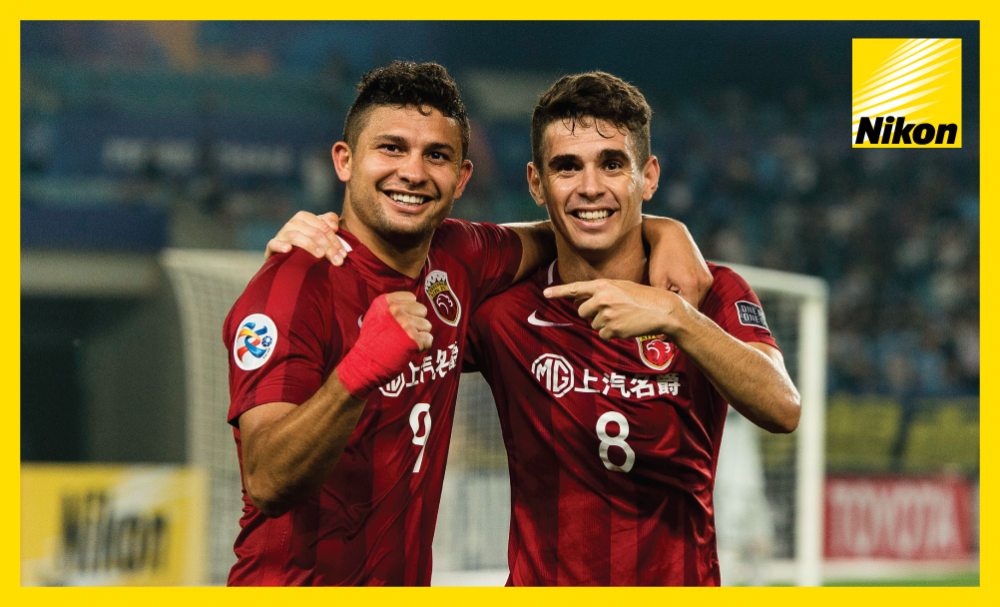 Elkeson and Oscar enjoy the 3-2 second leg win over Jiangsu FC on Wednesday that sees Andre Villas Boas' Shanghai SIPG into the AFC Champions League quarter-finals with a 5-3 aggregate victory.