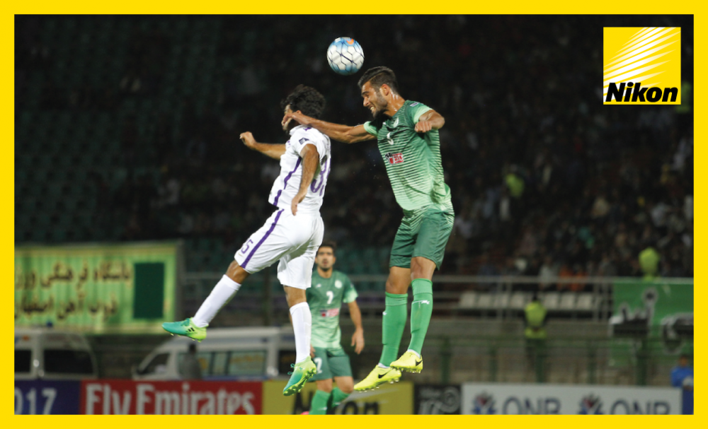 Zobahan's Vahid Mohammadzadeh soars high to head clear but the Iranian side succumb to a 3-0 home loss to Al Ain in Group C as the 2016 AFC Champions League runners-up book their place in the knockout round on Monday.