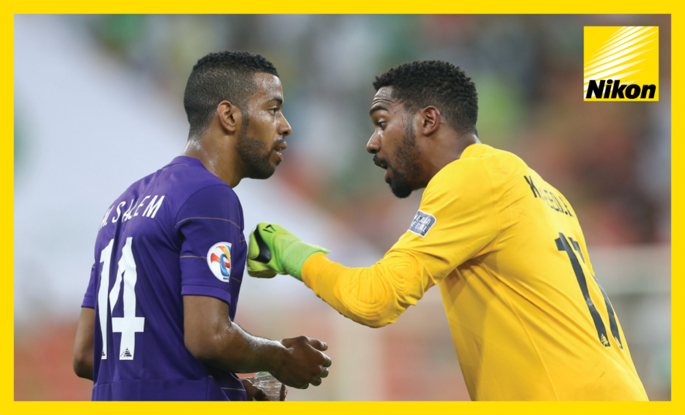 Team Talk: Khalid Eisa offers Mohammed Salem words of advice during Al Ain's AFC Champions League 2-2 draw with Saudi Arabia's Al Ahli in Group C on Monday.