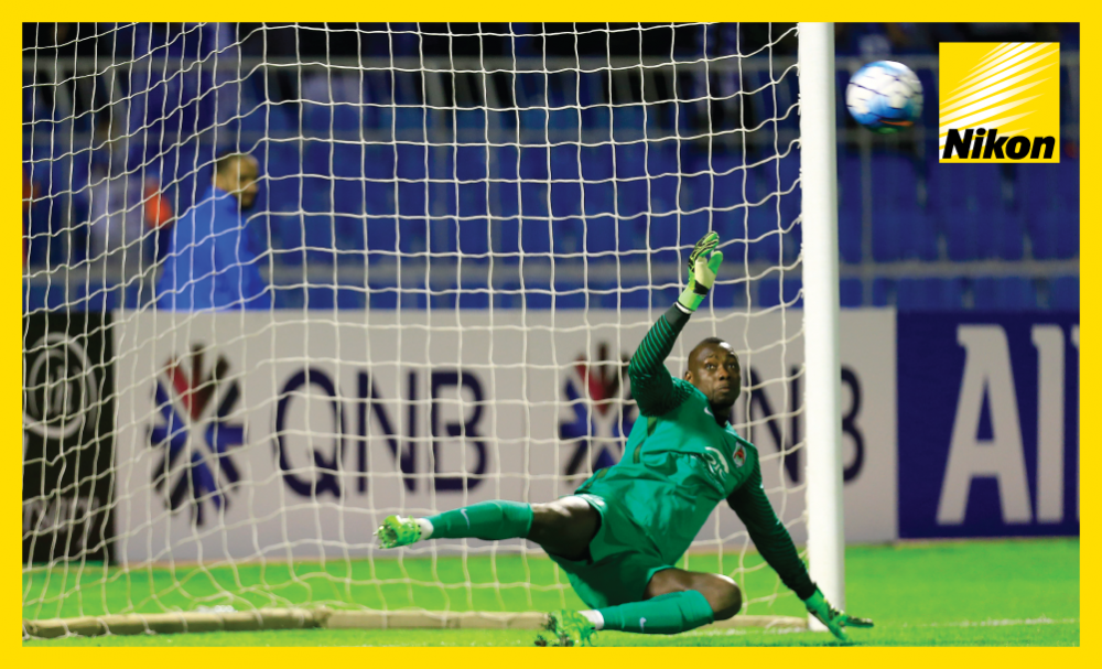 Al Rayyan 'keeper Oumar Barry looks on in despair as Al Hilal substitute Mohammad Al Shaloub's late penalty flies past him in the AFC Champions League on Matchday Two.