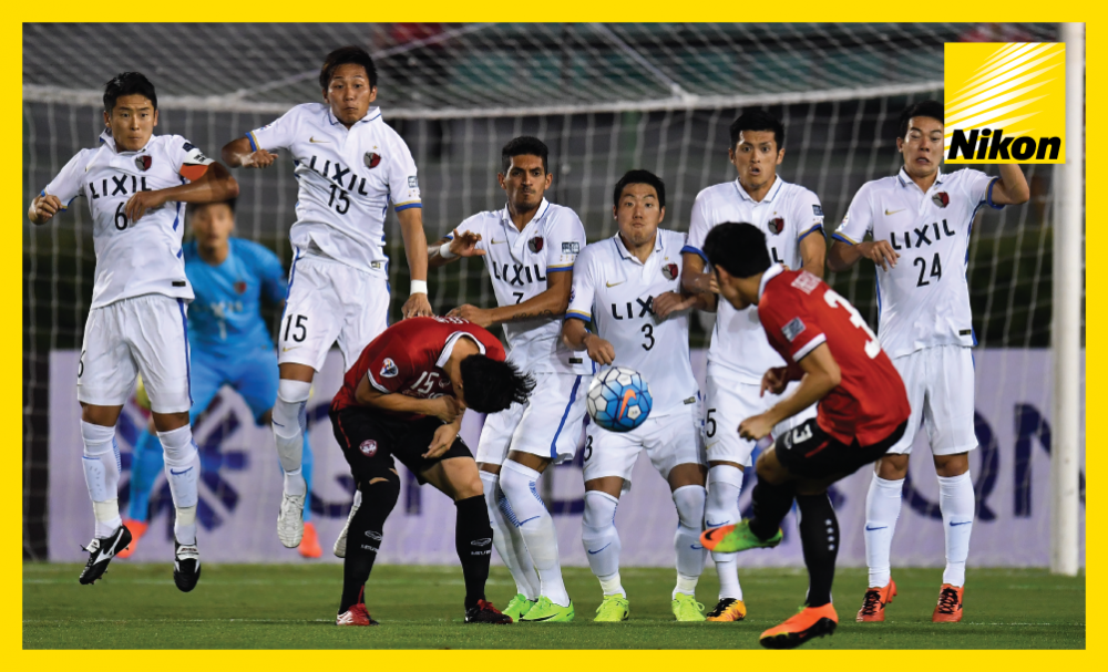 Muangthong United's Theerathon Bunmathan (#3) sidefoots his set-piece home to open the scoring in the AFC Champions League Matchday Two win over Kashima Antlers.