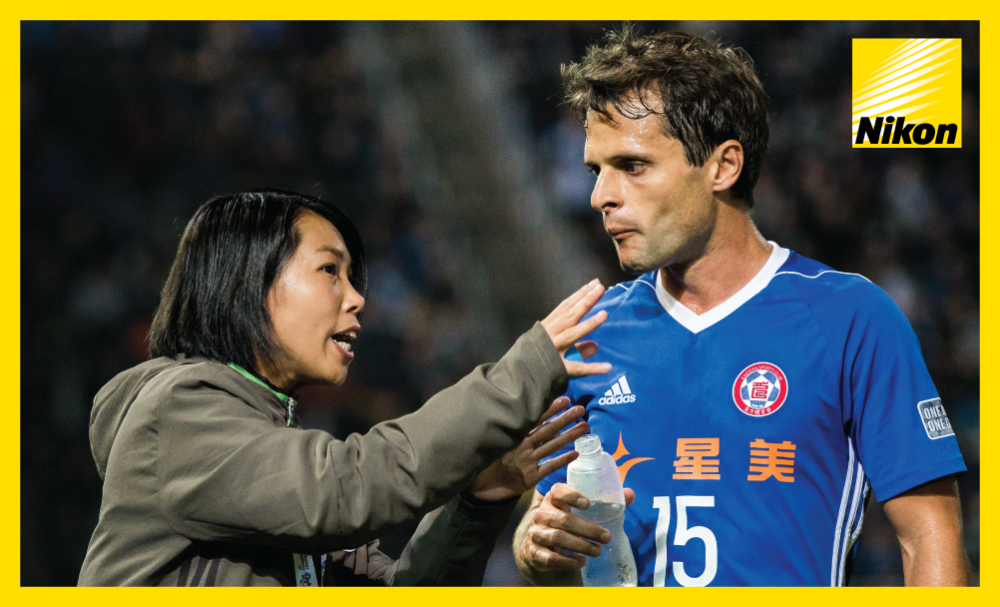 Eastern SC coach Chan Yuen-ting passes on instructions to defender Roberto during the 1-1 AFC Champions League draw with Kawasaki Frontale on Matchday Two.