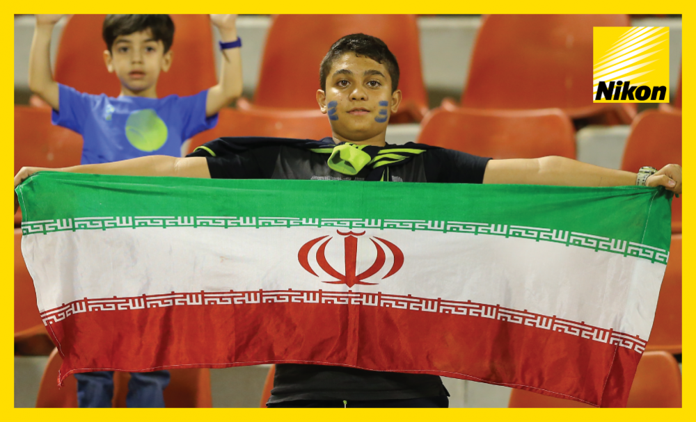 Two young fans at the AFC Champions League Matchday Two game between Esteghlal and Al Taawoun show their support for the Iranian club.