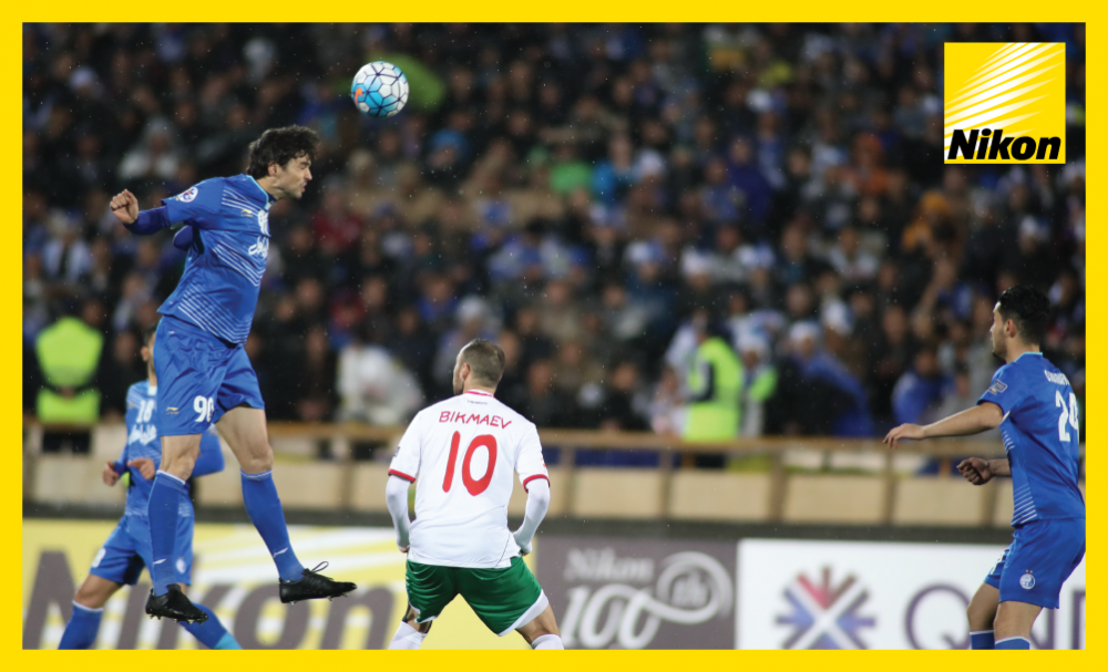 Leaping Leandro: Esteghlal defender Leandro Padovani heads clear in 2-0 win over Lokomotiv in Group A of the AFC Champions League on Monday.