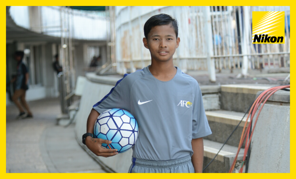 A ball boy poses for the camera ahead of the 2017 AFC Cup Matchday Two encounter between Magwe United and  Johor Darul Ta'zim.