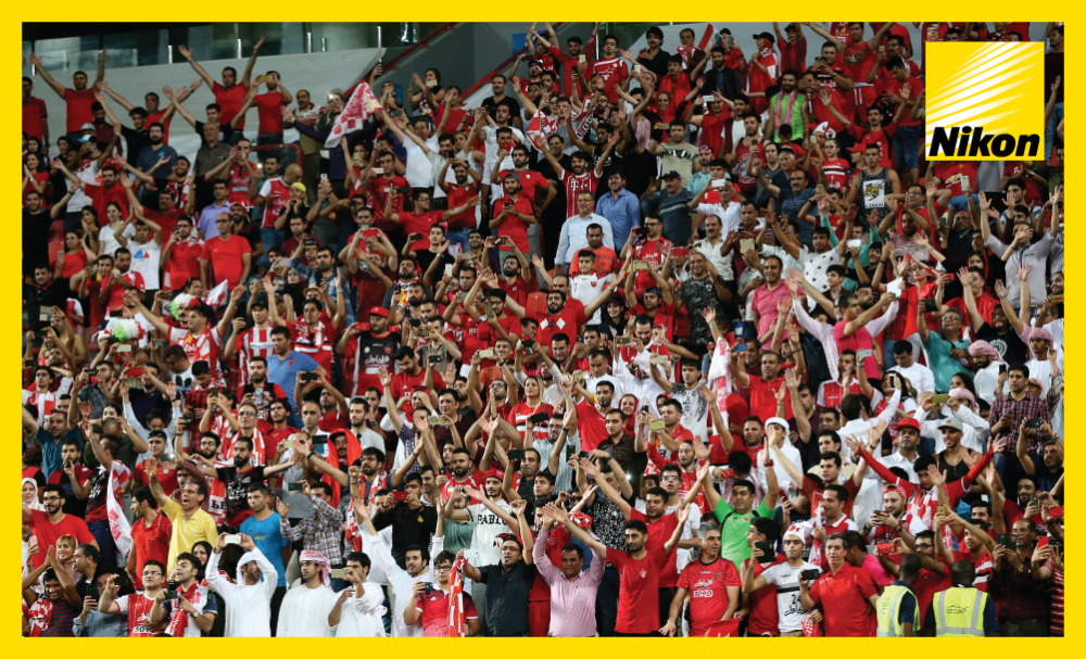 Persepolis fans cheer their team on in Abu Dhabi as the Tehran giants beat Al Ahli of Saudi Arabia 3-1 in the United Arab Emirates to complete a 5-3 quarter-final aggregate victory.