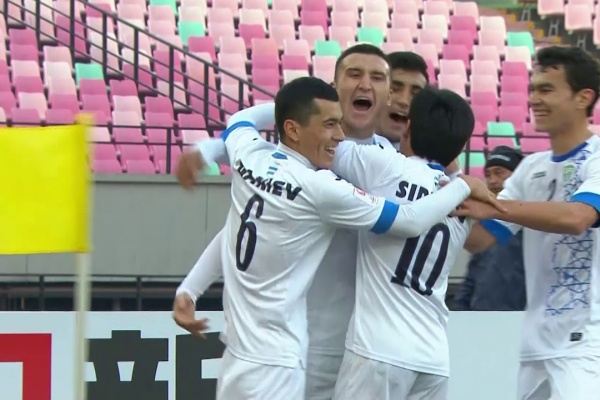 Uzbekistan are 1-0 up after a goalmouth scramble!